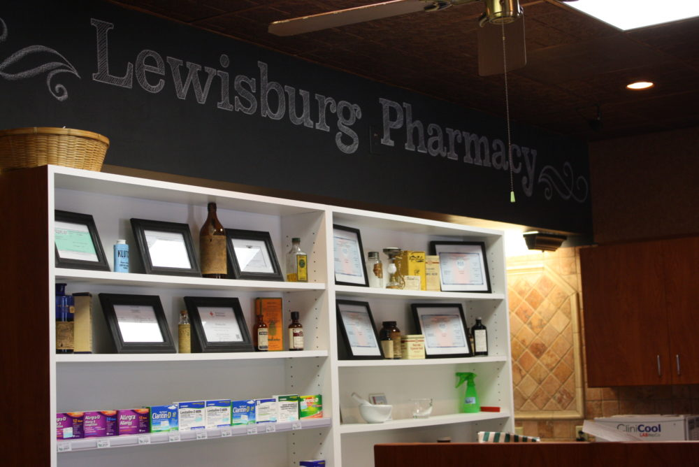 Behind the counter at Lewisburg Pharmacy.